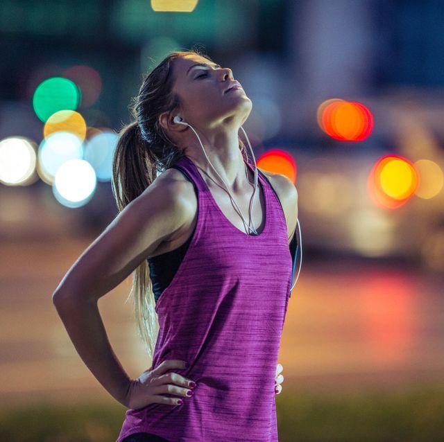 vrouw hardloopshirt paars mouwloos top singlet shirt sportshirt