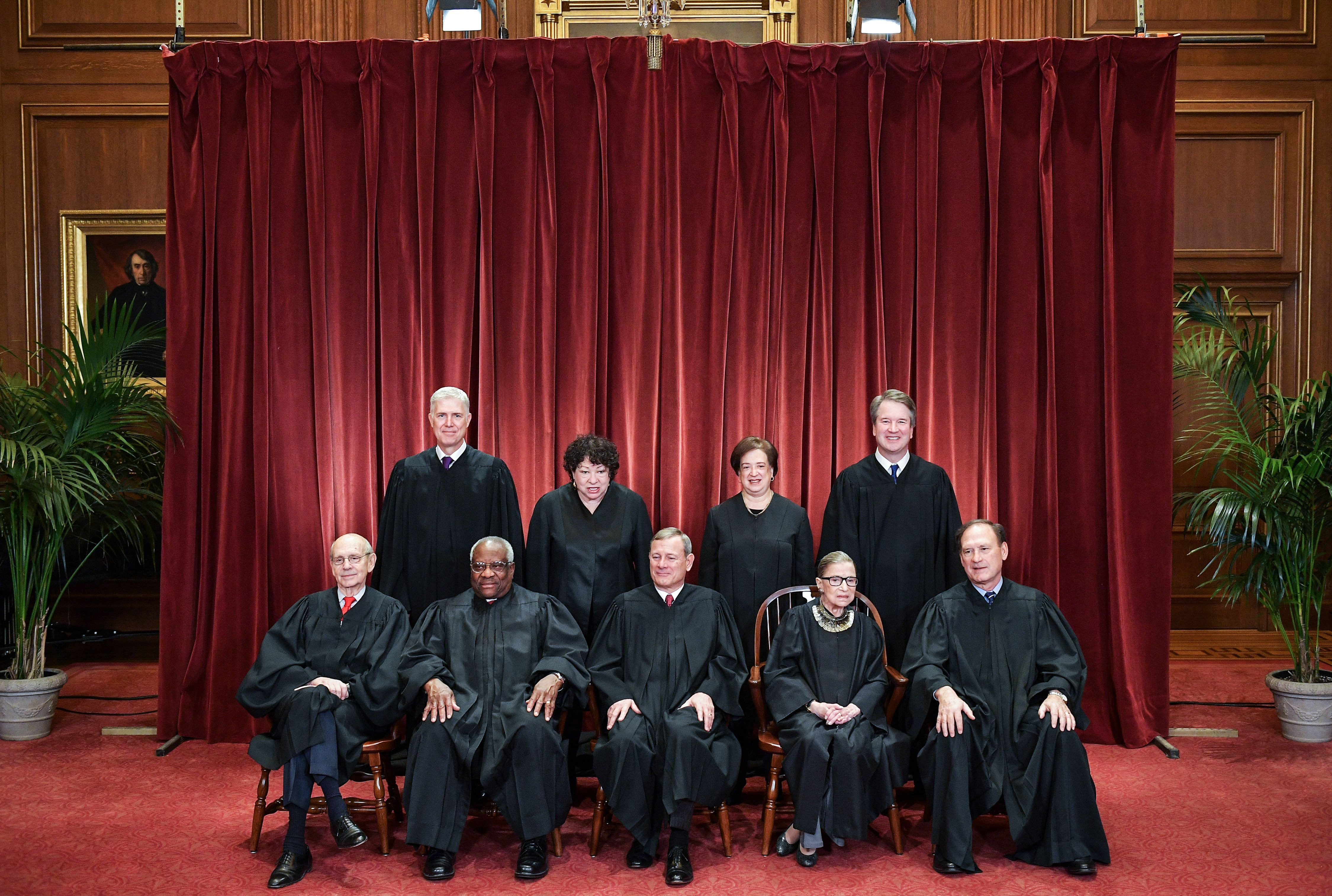 Supreme Court Justices pose for their official photo.