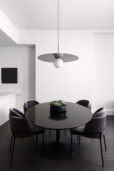 dining room, black dining table with dark purple leather chairs