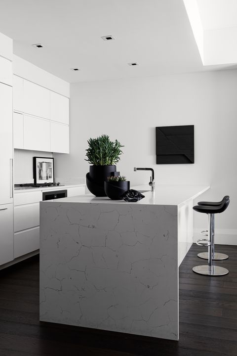 kitchen, white marble countertop white cabinets, black bar stools