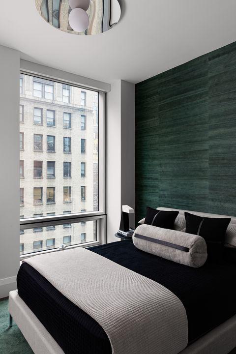 queen bed, black bed sheets, gray throw blanket
