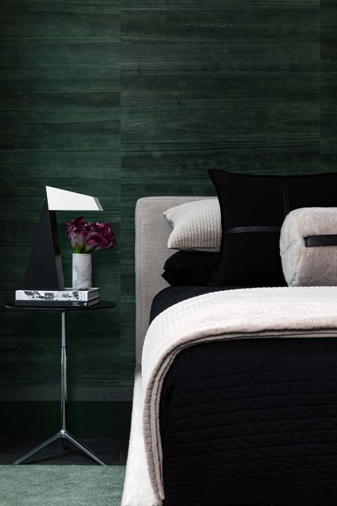 bedroom, black bed sheets, green wall covering