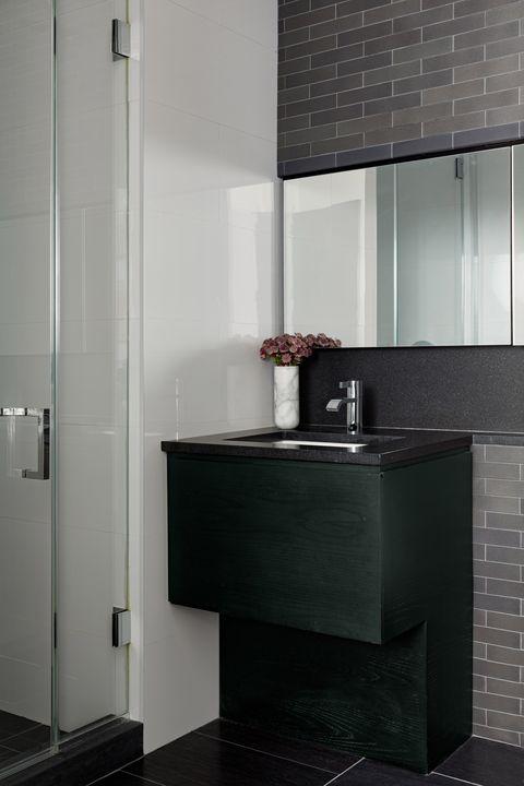 bathroom, green vanity with black countertop
