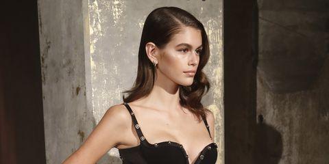 Hair, Beauty, Hairstyle, Model, Fashion model, Fashion, Brassiere, Lip, Brown hair, Long hair,