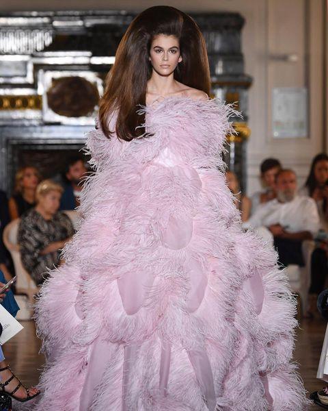 Fashion model, Haute couture, Fashion, Dress, Fashion show, Clothing, Gown, Shoulder, Wedding dress, Pink,