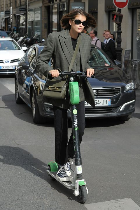 Kaia Gerber Riding a Scooter During Paris Fashion Week
