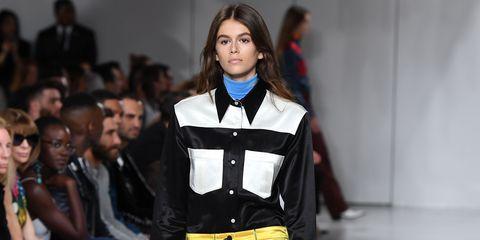 Fashion model, Fashion show, Runway, Fashion, Clothing, Fashion design, Yellow, Event, Footwear, Trousers,
