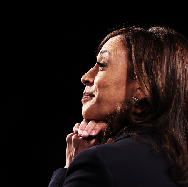 kamala harris at the vice presidential debate smiling in profile view with her hands under her chin