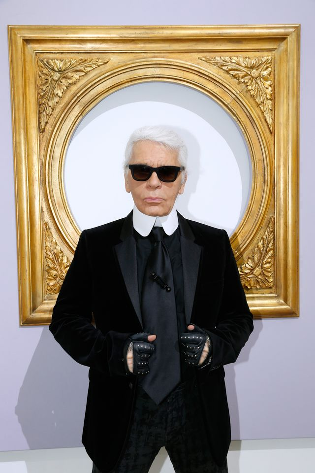 paris, france   october 01  editors note this image has been retouched fashion designer karl lagerfeld poses in front of his works before the chanel show as part of the paris fashion week womenswear  springsummer 2014, held at grand palais on october 1, 2013 in paris, france  photo by bertrand rindoff petroffgetty images