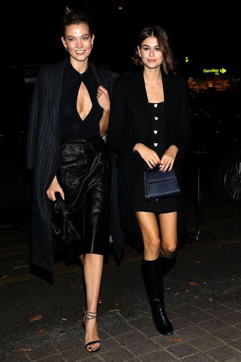 Little black dress, Clothing, Fashion, Fashion model, Dress, Leg, Cocktail dress, Joint, Thigh, Shoulder,