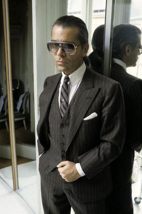 Suit, Formal wear, Tuxedo, White-collar worker, Businessperson, Outerwear, Eyewear, Blazer, Glasses, Vision care,