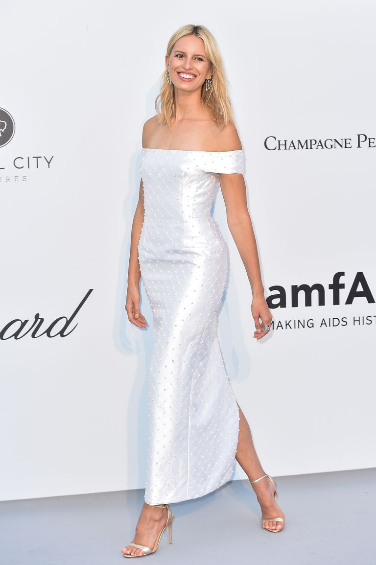Karolína Kurková In a white off-the-shoulder dotted dress by Gabriela Hearst.