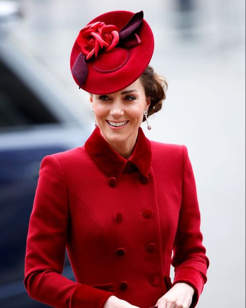 catherine, duchess of cambridge wears a red jacket and matching hat as she walks away from a car