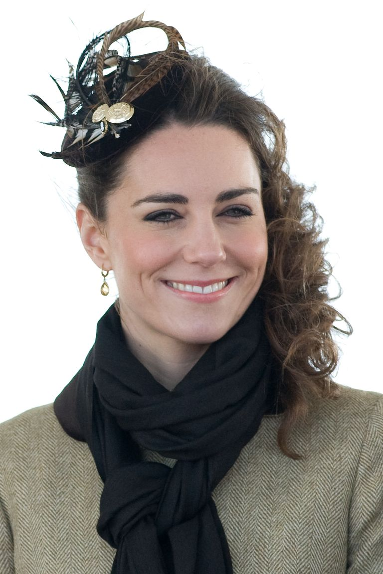 Middleton swept ringlets to her left side and added a decorative  feathered headpiece for this pretty look.