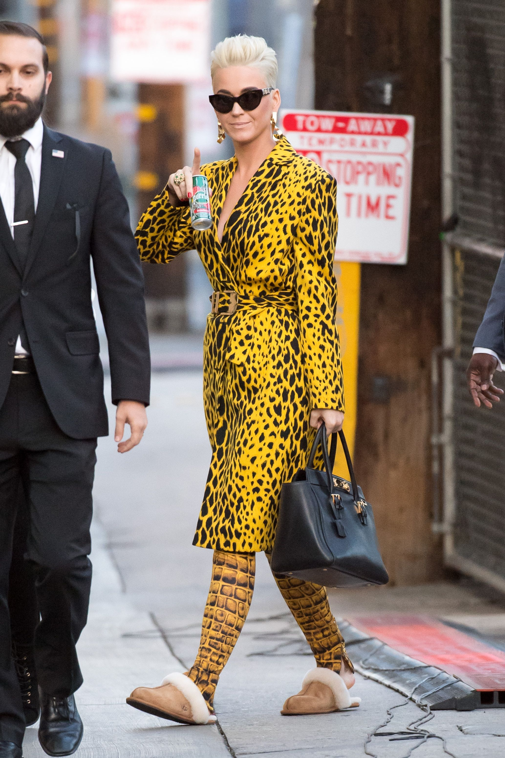 Katy Perry Taking a page out of Tiffany Haddish's book, Katy Perry left Jimmy Kimmel Live in a pair of UGG slippers the day after the Oscars. She wore the shoes with a yellow leopard trench and geometric print trousers.