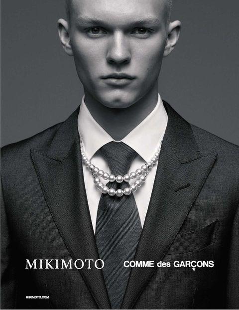 Suit, Formal wear, Model, Tuxedo, Beauty, Chin, Forehead, Tie, Bow tie, White-collar worker,