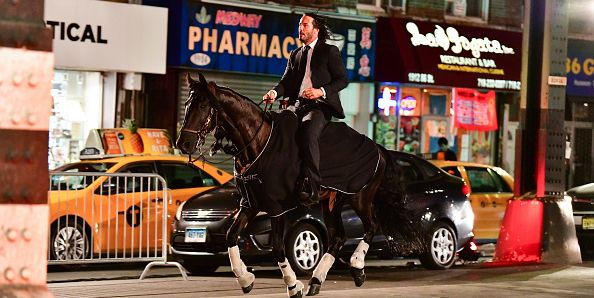 https://hips.hearstapps.com/hmg-prod.s3.amazonaws.com/images/keanu-reeves-seen-riding-a-horse-on-location-for-john-wick-news-photo-999419850-1531753304.jpg?crop=1.00xw:0.747xh;0,0.124xh&resize=768:*