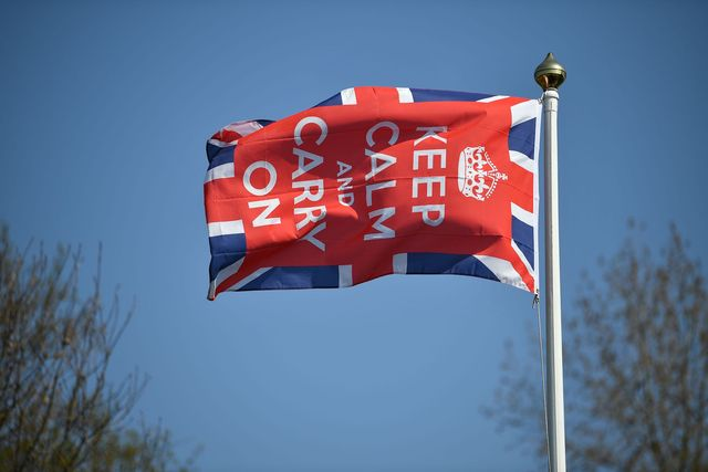 a keep calm and carry on flag flies in the garden of a home in bodiam, southern england, on april 9, 2020 as britain continued to battle the outbreak of new coronavirus and the governement prepared to extend the nationwide lockdown   the disease has struck at the heart of the british government, infected more than 60,000 people nationwide and killed over 7,000, with another record daily death toll of 938 reported on april 8 photo by ben stansall  afp photo by ben stansallafp via getty images