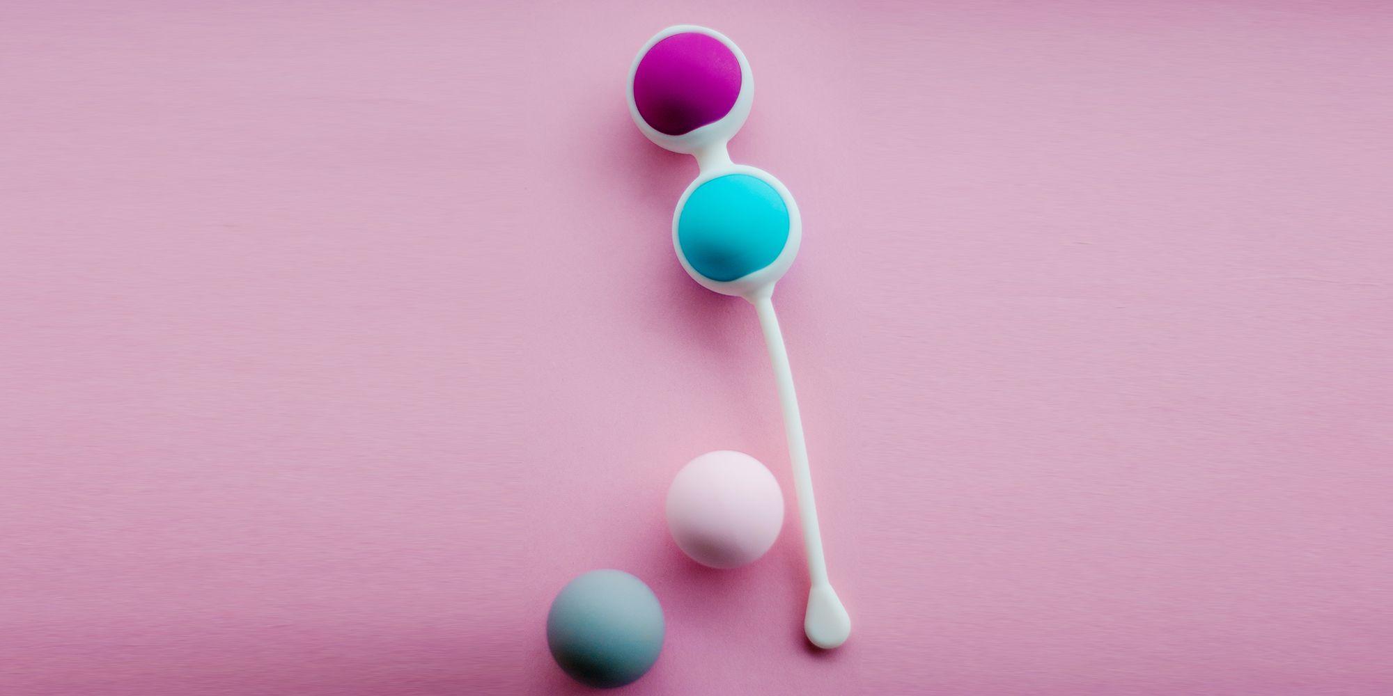 Color Kegel Balls Geisha Balls In Pink Background