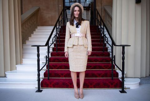 9ffdae568ac Keira Knightley wears Chanel couture to collect her OBE at ...