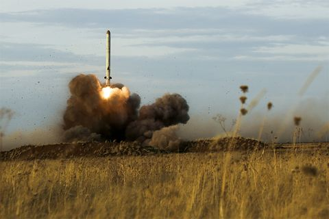 Explosion, Missile, Ecoregion, Grass family, Smoke, Vehicle, Rocket, Steppe, Grassland,