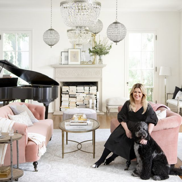 kelly clarkson posing in room with furniture from her wayfair collection