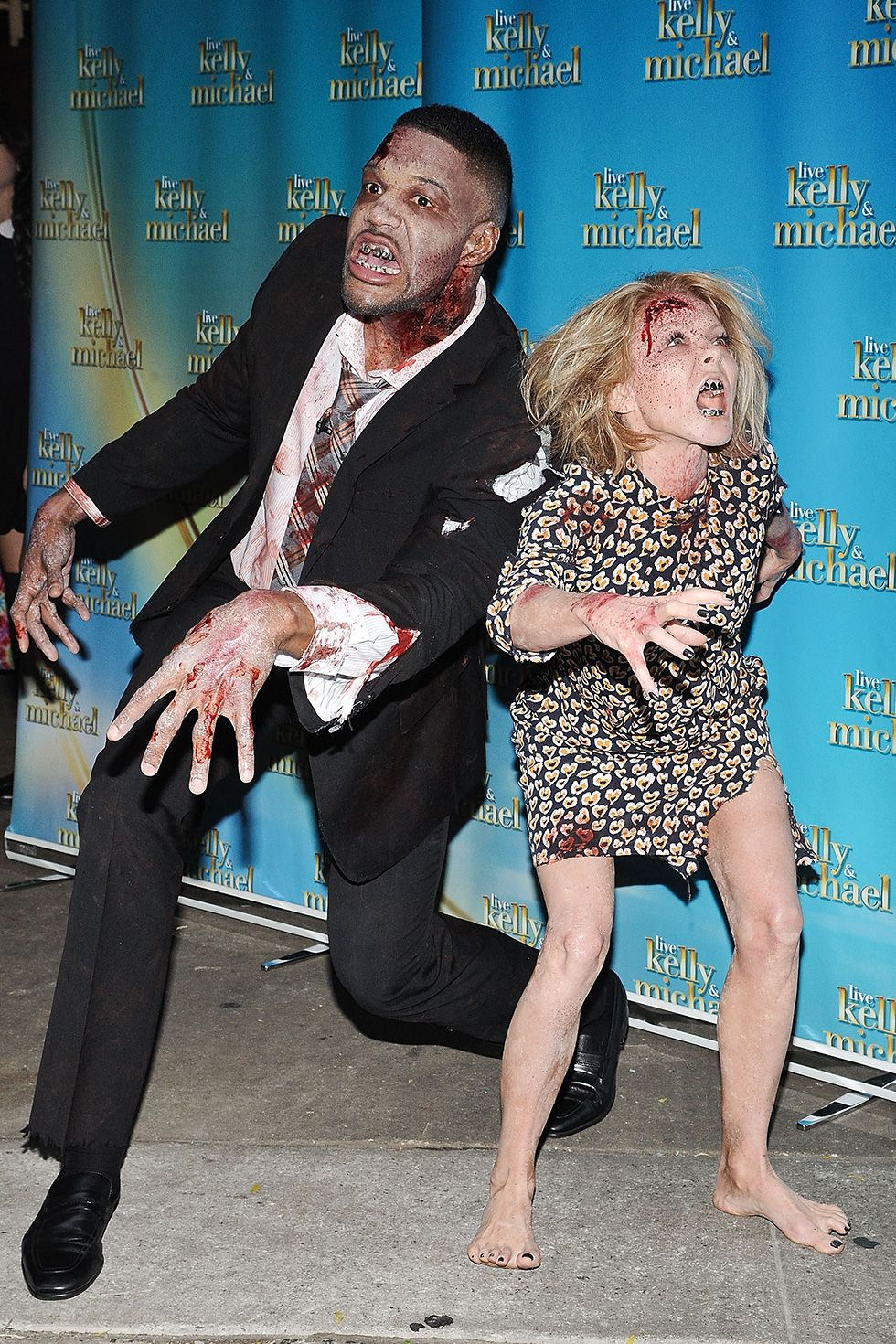 Michael Strahan and Kelly Ripa - Zombies Michael Strahan and Kelly Ripa rocked their best zombie looks in 2014 for the Live With Kelly & Michael Halloween show. Dance moves not necessary.