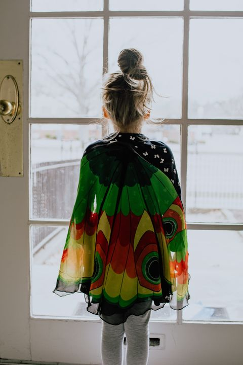 girl playing indoors