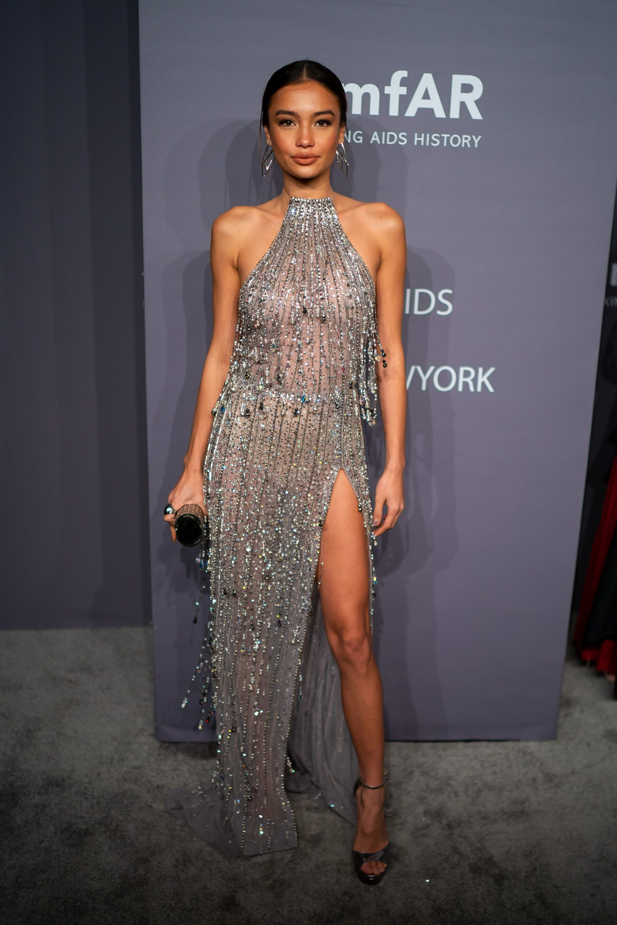Kelsey Merritt Seems like models love to wear beaded sheer dresses, huh? The 22-year-old star rocked this Georges Hobeika thigh-high slit dress to the amfAR Gala in New York City.