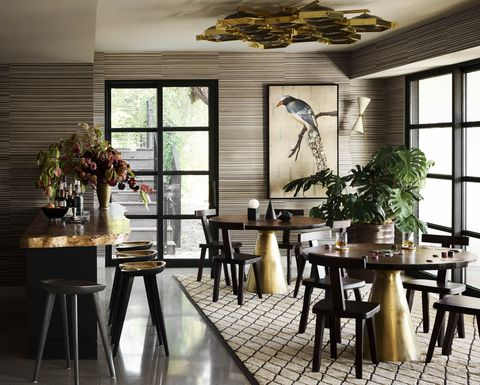 gleaming metallics lend 1940s glamour to the lounge and the tables and stools are crafted of cast and forged brass