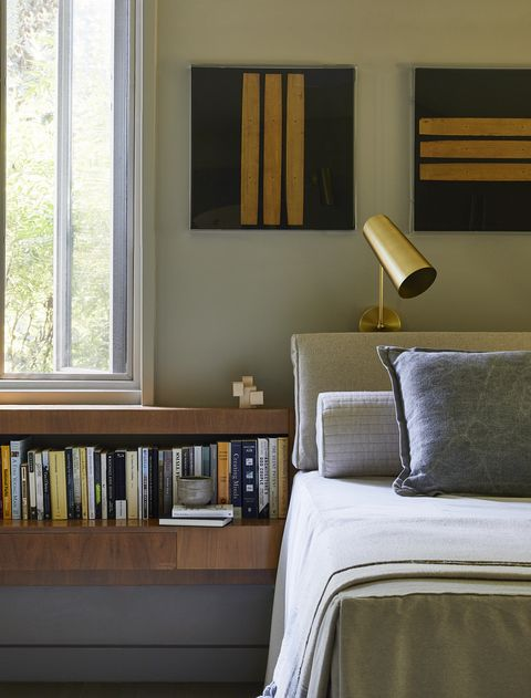 a collection of lucite framed prayer scripts hangs over the bed