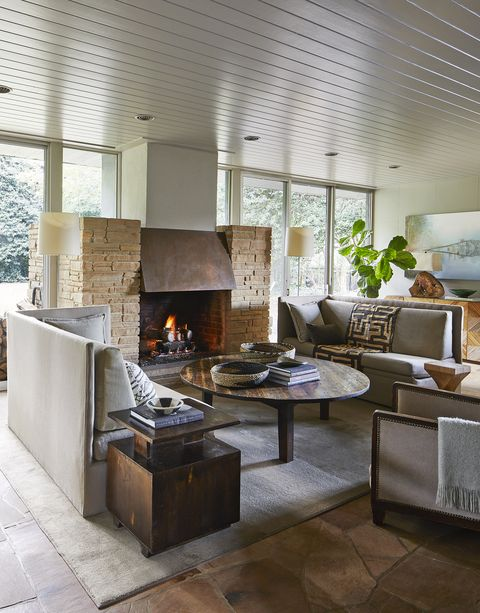 a stone and copper hearth warms a sitting room