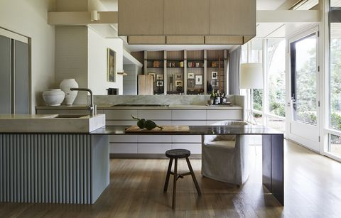 a thin plated steel prep counter extends off the sink to face the den