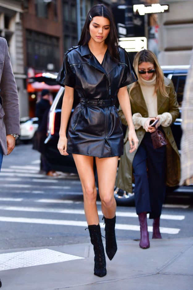 February 9, 2019 The model arrived to Longchamp's fall 2019 runway show in NYC. She chose a leather minidress from the fashion house and paired it with sock boots.