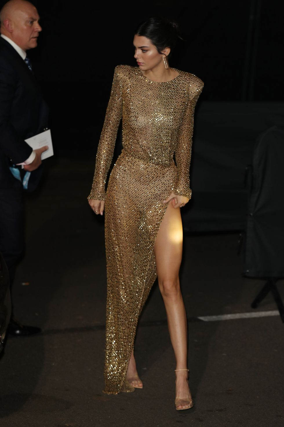 December 10, 2018 Kendall arrived for the The Fashion Awards 2018 in NYC. She, not surprisingly, chose a gold naked dress by Welsh designer Julien Macdonald.