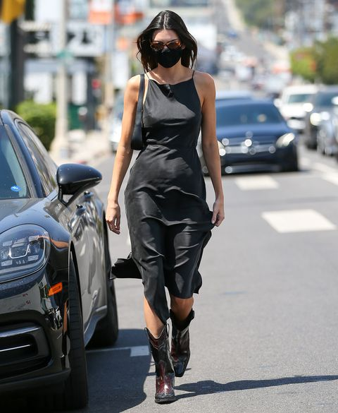 kendall jenner in a dress and cowboy boots