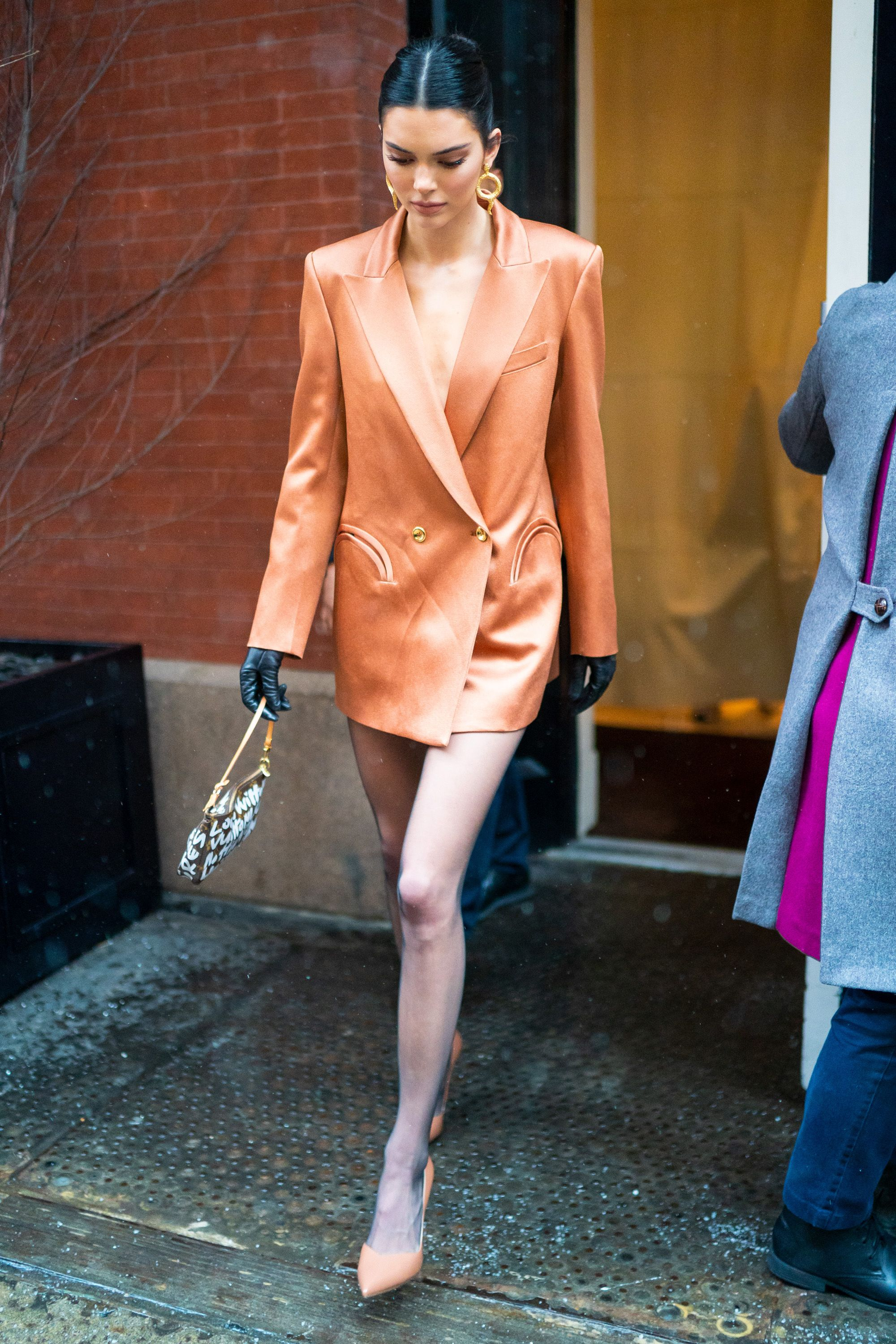 February 12, 2019 I will only wear blazer dresses from now on because of Kendall Jenner. She looked smart, sophisticated, and daring in this structured orange Blazé Milano number.
