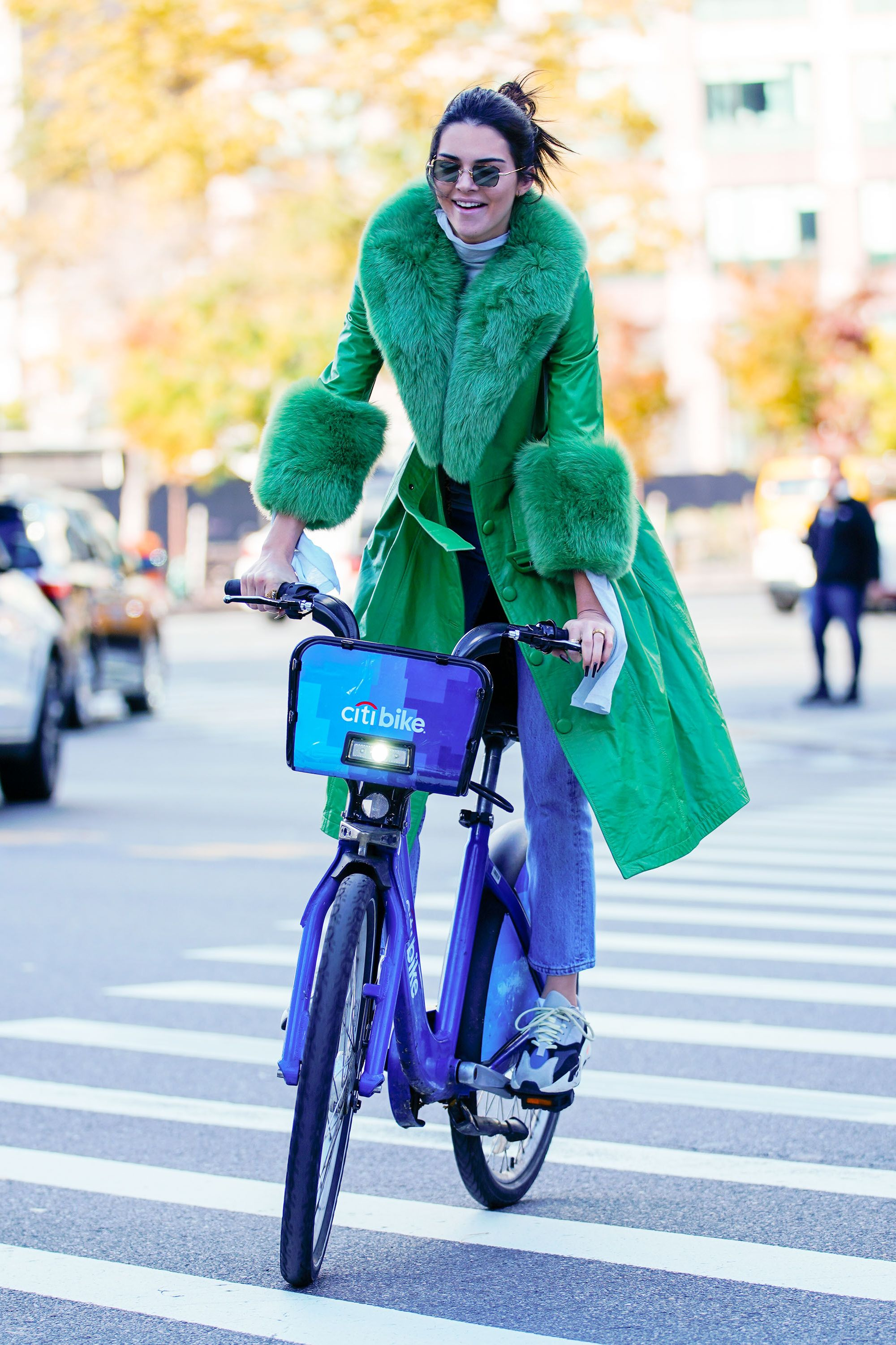 November 3, 2018 It would be hard to miss Kendall on a Citi Bike in NYC thanks to her furry green coat from Saks Potts . The star had decided to go for a quick ride on her 23rd birthday.