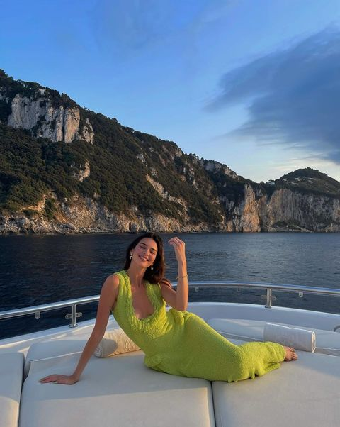 kendall jenner in neon green towel dress spends a day on a yacht and looks like she's wearing a great red carpet look