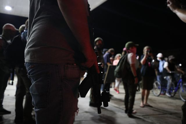 kenosha, wisconsin, usa   august 25 armed civilians stand in the streets of kenosha to protect the area against the arson during third day of protests over the shooting of a black man jacob blake by police officer in wisconsin, united states on august 25, 2020 photo by tayfun coskunanadolu agency via getty images
