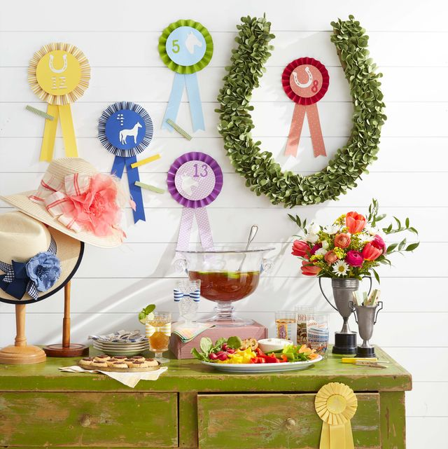"""kentucky derby day party kentucky benedictine dip, betting ribbons, hats on vintage stands, horseshoe """"wreath"""", flowers in vintage trophy """"vases"""""""
