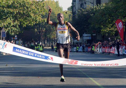 Kenyan runner Sammy Kitwara jubilates as