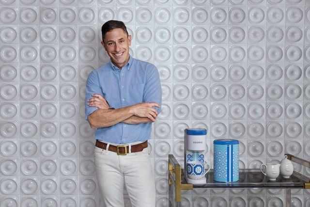 man standing next to coffee machine