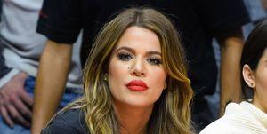 Khloe Kardashian cheering Tristan Thompson on at his basketball game