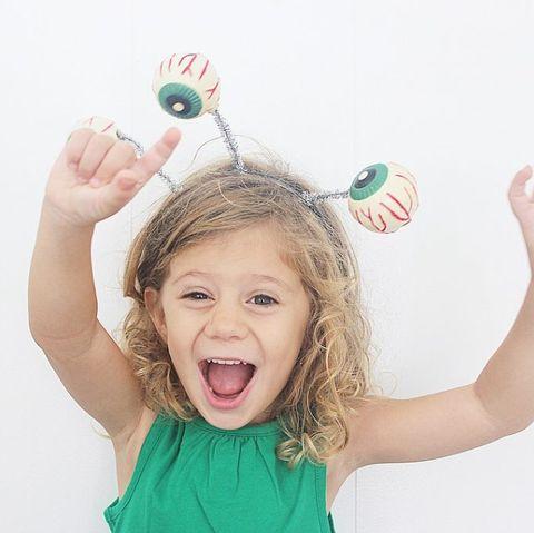 child wearing alien costume