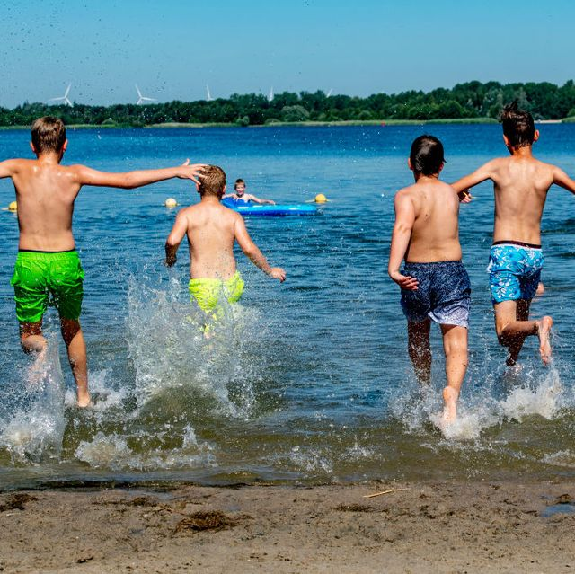 kids cool off from the stuffy conditions due to the high