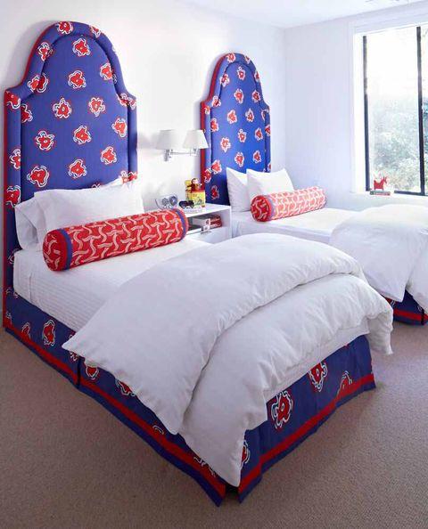 Bedroom, Bedding, Bed sheet, Blue, Bed, Furniture, Red, Room, Bed frame, Textile,