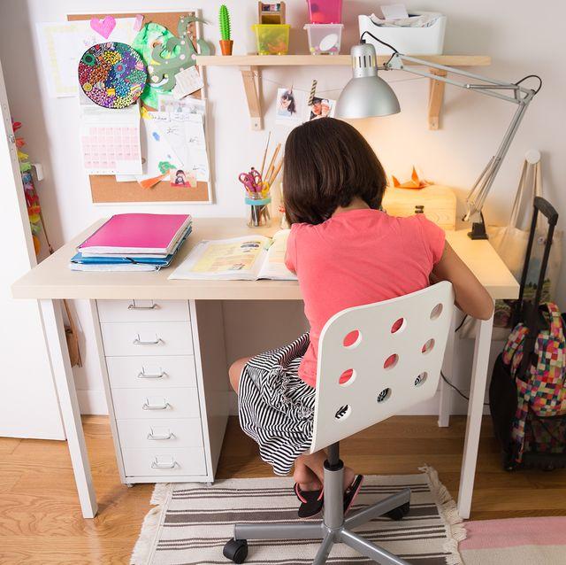 girl sitting in desk chair