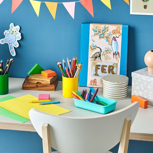 kids desk with art supplies and toys