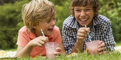 Kids Drinking Milkshakes on Picnic Blanket